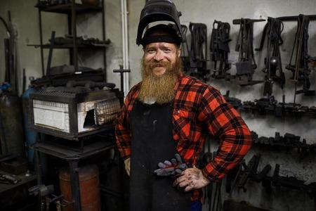 Satisfied welder in mask on head
