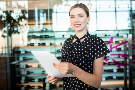 Charming woman working in shop