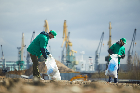 Activists picking garbage on site Stock Photo