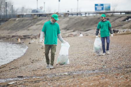 Volunteers walking with litter bags