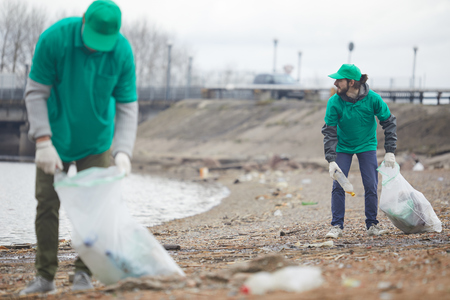 Volunteers picking litter on shore