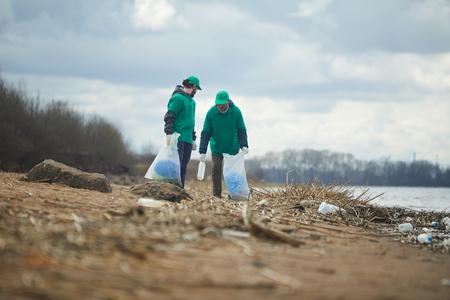 Volunteers collecting litter on shore