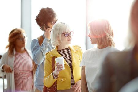 Women talking in airport queue