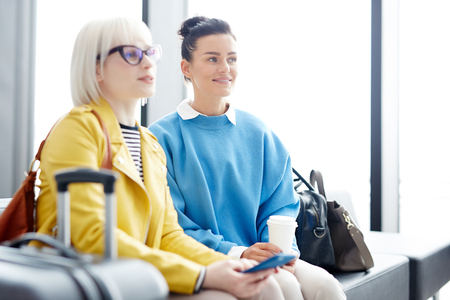 Women sitting in airport together