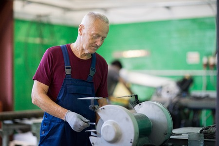 Man working on lathe machine