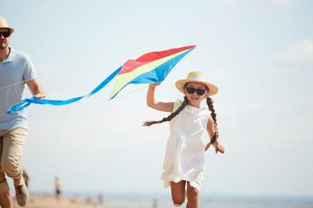 Playing kite with father Фото со стока