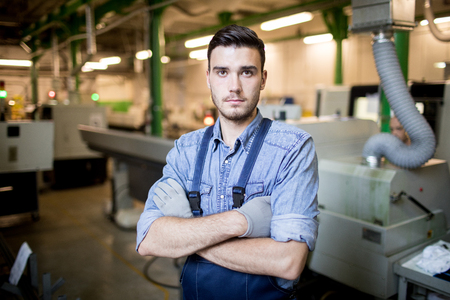 Worker standing in factory