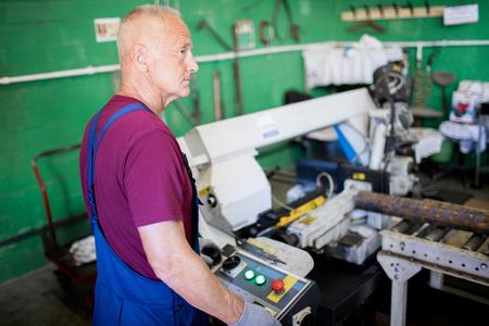 Operator standing at machine