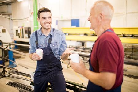 Workers taking break in factory Reklamní fotografie