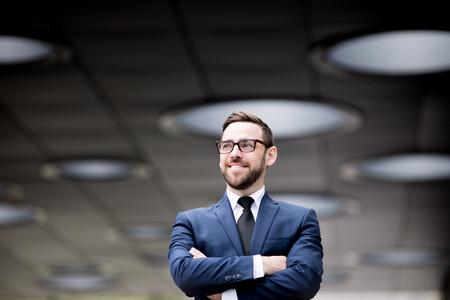 Smiling man crossing hands