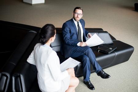 Man looking at woman on sofa