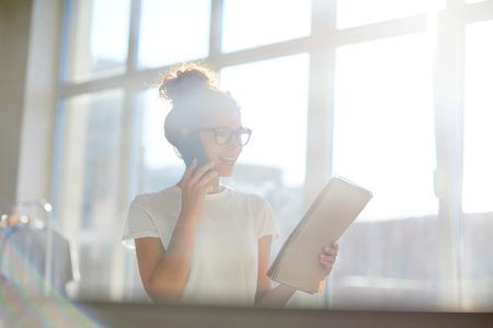 a business woman phoning clients Standard-Bild - 107148656
