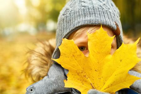 Face behind leaf
