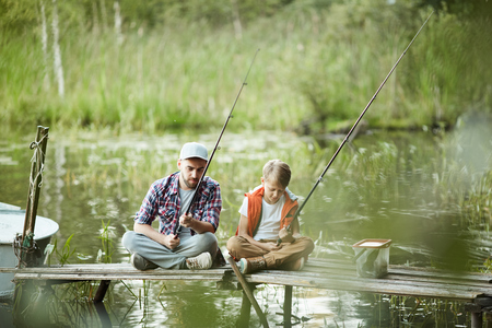 Family fishing on the river