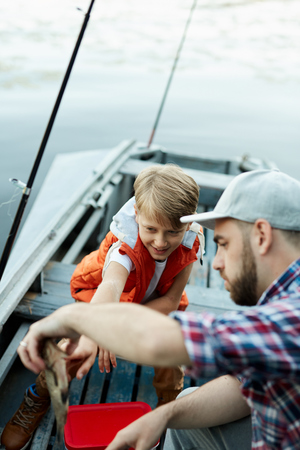 Father and son catching a fish