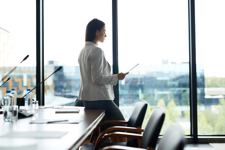 Businesswoman Alone in Conference Room Stock Photo