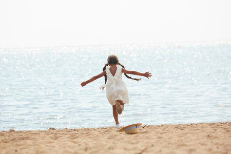 Happy Little Girl Running to Sea