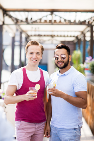 Two Friends Posing in Bar Stock Photo