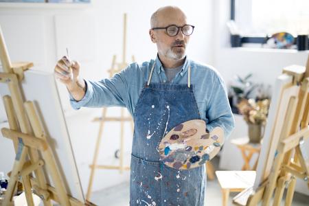 Painting in studio Foto de archivo