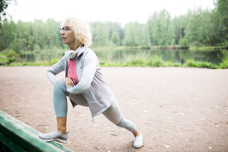 Exercising by waterside Stock Photo