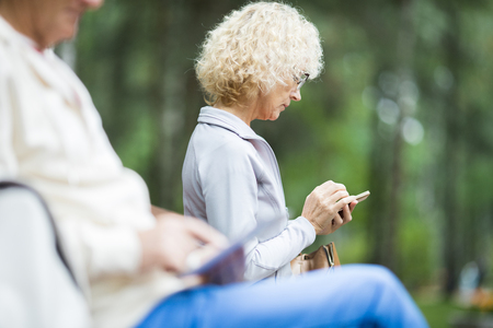 Messaging in park Stock Photo