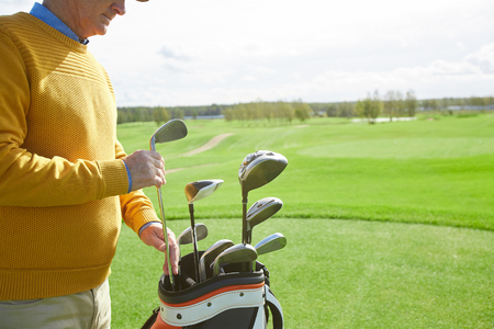 Taking golf club Stock Photo
