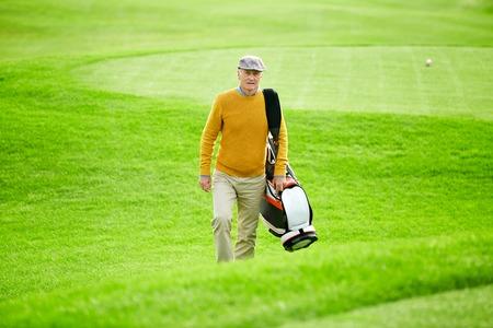 Hurrying for golf Banco de Imagens