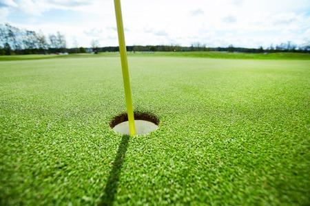 Golf hole on lawn