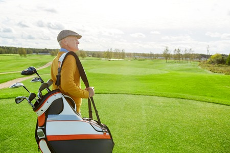 Golfer with clubs