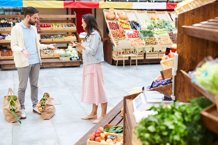 Couple fighting in food shop Stock Photo