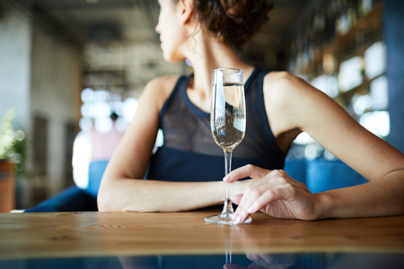 Woman with champagne Standard-Bild - 115176687
