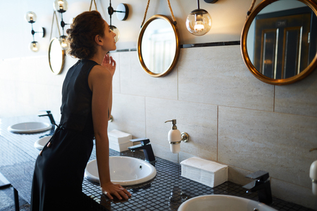 Woman in bathroom Standard-Bild