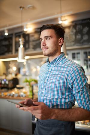 Waiter with touchpad Zdjęcie Seryjne