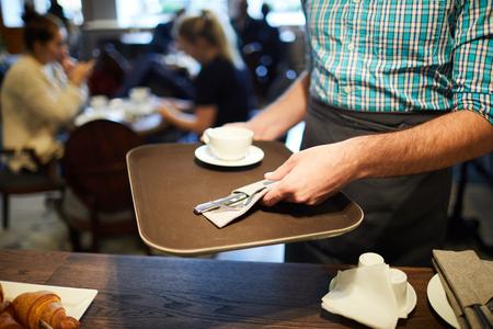 Working as waiter Zdjęcie Seryjne