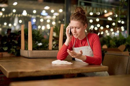 Sharing problems by phone Stock Photo