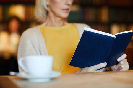 Reading in coffee shop Banco de Imagens