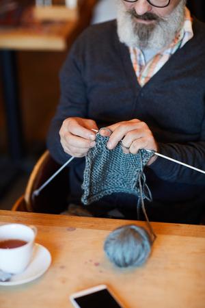 Knitting by table Фото со стока - 112560632