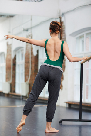 Dancing by gymnastic bar Stock Photo