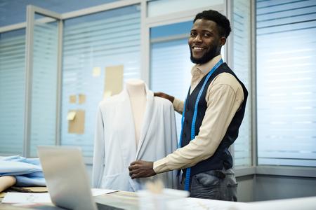 Black fashion designer making elegant jacket