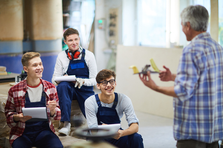 Excited carpentry students laughing during interesting class Imagens - 113325777
