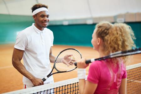 Guy with racket Standard-Bild
