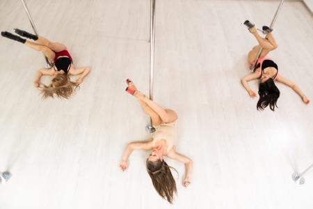 Exercising by poles Standard-Bild - 113326328