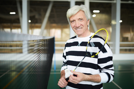 Aged badminton player