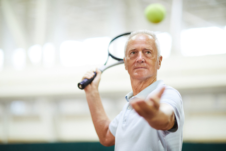 Throwing tennis ball 写真素材