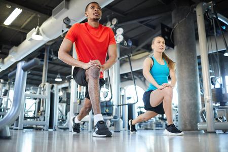 Doing exercise after coach Standard-Bild