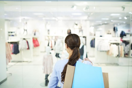 Girl in clothes department