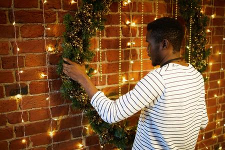 Guy with xmas wreath