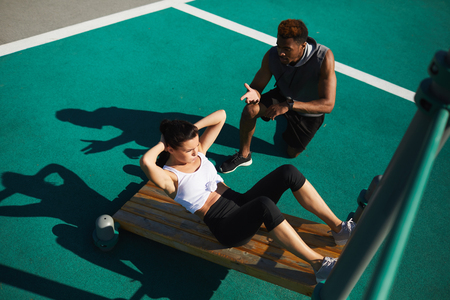 Fitness trainer giving advice to woman Stock Photo
