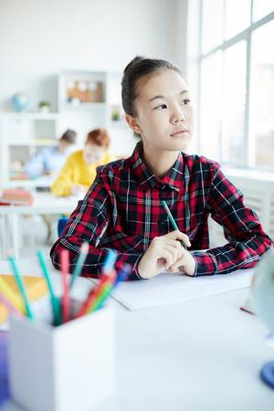 Schoolgirl by window Banque d'images