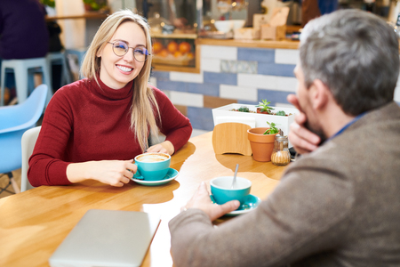 Woman talking to colleague